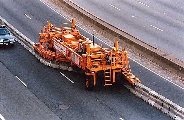 zipper machine movable barrier